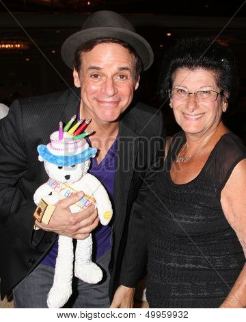 LOS ANGELES - AUG 24:  Christian LeBlanc and fan who gave him birthday gifts at the Young & Restless Fan Club Dinner at the Universal Sheraton Hotel on August 24, 2013 in Los Angeles, CA