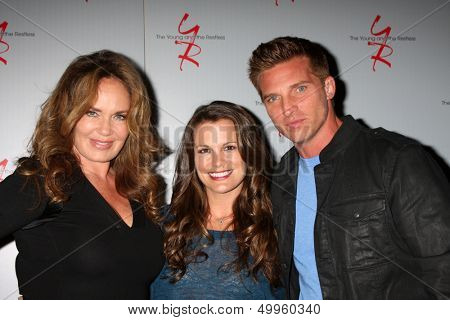 LOS ANGELES - AUG 24:  Catherine Bach, Melissa Claire Egan, Steve Burton at the Young & Restless Fan Club Dinner at the Universal Sheraton Hotel on August 24, 2013 in Los Angeles, CA