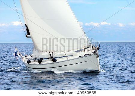 Sailing Boat On Open Sea Sailing On Port Tacks
