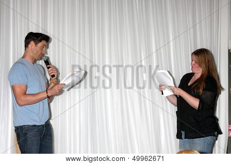 LOS ANGELES - AUG 25:  Daniel Goddard, Fan doing a scene from a YnR script at the Goddard and Khalil Fan Event at the Universal Sheraton Hotel on August 25, 2013 in Los Angeles, CA