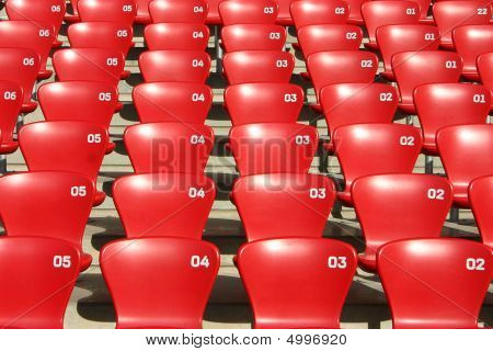 Red Tribune Seats in a stadium - front view
