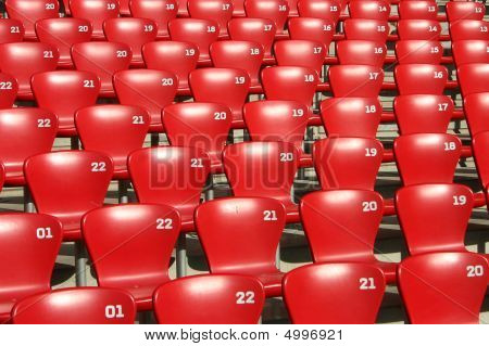 Red Tribune Seats in a stadium - side view