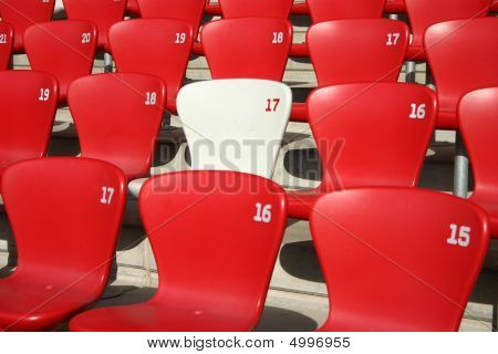 Red Tribune Seats in a stadium - detail view