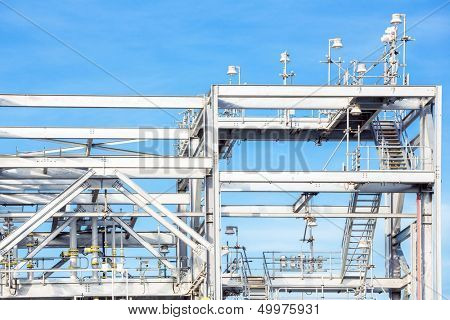 Assembling of liquefied natural gas Refinery Factory with LNG storage tank using for Oil and gas industry background