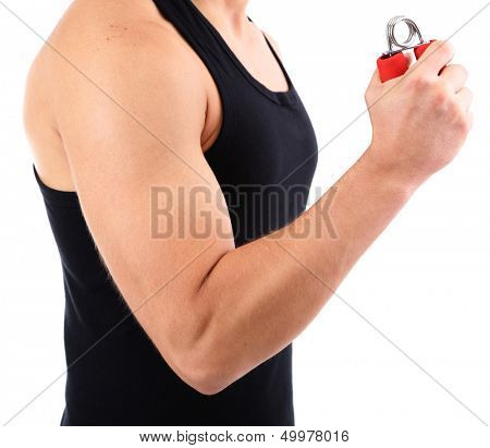 Handsome young muscular sportsman with expander, isolated on white