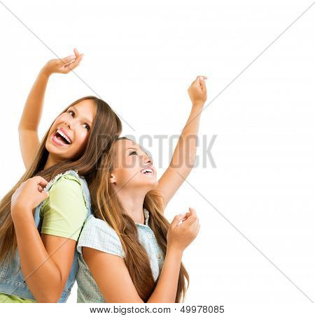 Happy and Laughing Teenage Girls Dancing. Hands up. Beauty Teenagers Having Fun together. Girlfriends