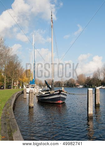 Small Sailing Boat Moored On A River