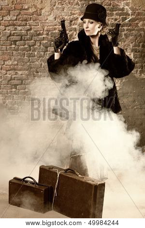 Dangerous lady with a revolver wearing titanic style vintage clothing