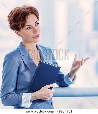 Closeup portrait of intelligent young business woman making deal, successful female at work, CEO of great company, success concept