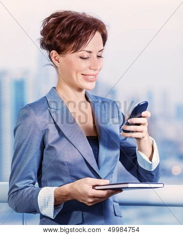 Closeup portrait of pretty young woman calling to business partner, beautiful executive manager, good worker, active job, successful career concept