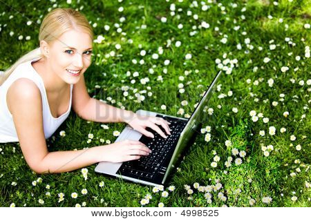 Woman Using Laptop Outdoors