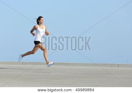 Beautiful Woman Running With The Sky In The Background