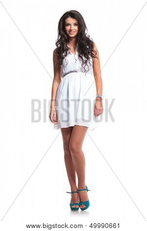 full length picture of a young beautiful woman smiling for the camera. isolated on a white background