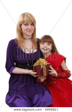 Mother And Daughter With Gift.