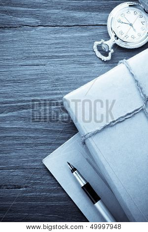 parcel wrapped with brown paper at wood background