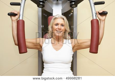 An image of a mature woman doing fitness