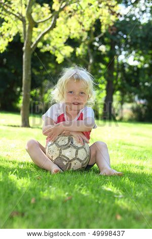 Happy young girl with soccer ball