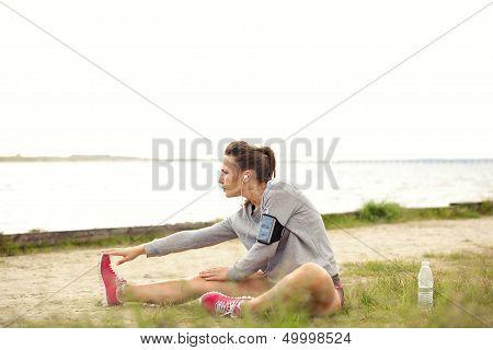 Female Runner Doing Stretching Outside
