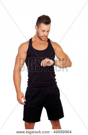 Handsome sportsman looking at his watch isolated on white background