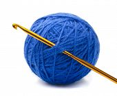 Ball of blue yarn and crochet hook isolated on white