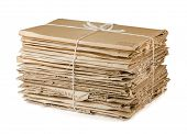 stock photo of reuse recycle  - Waste cardboard bundle for recycling isolated on white - JPG