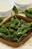 stock photo of pimiento  - Fried green peppers in salt - JPG