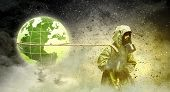 picture of respiration  - Man in respirator against nuclear background - JPG