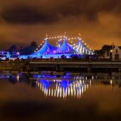 "stock photo of galway  - ""Big Top"" circus style blue tent and row of lights on the bank of Corrib river in Galway Ireland - JPG"
