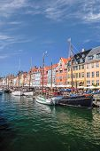 Old Boats And Houses In Nyhavn In Copenhagen poster
