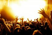 stock photo of cheers  - silhouettes of concert crowd in front of bright stage lights - JPG