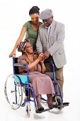 happy disabled senior african woman with husband and granddaughter on white background