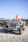 Ijmuiden, The Netherlands-may 5 2013: Army Jeep Of Organization Kelly's Heroes Riding On Beach On Ma