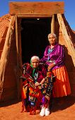 picture of mud-hut  - Elderly 99 year old Navajo Native American woman and her daughter standing in front of a traditional Hogan - JPG
