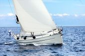stock photo of sails  - Sailing boat on open sea sailing onsaunny day - JPG