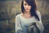 stock photo of freeze  - Beautiful girl freezing outdoor - JPG