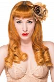 stock photo of chemise  - Beautiful young redhead in a peach color chemise - JPG