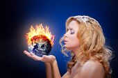 stock photo of hemisphere  - Frozen girl holding burning earth globe  - JPG