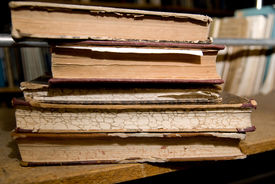 stock photo of annal  - Old books lying on a shelf in the library - JPG