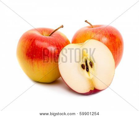 Three red apples on white