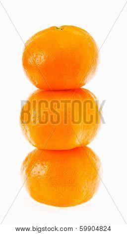 Stacked Fresh Mandarin Isolated On White Background.