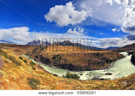Travel to Chile. The river bends a horseshoe under the flying clouds. The picture was taken Fisheye lens