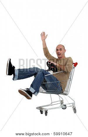 man driving a shopping cart