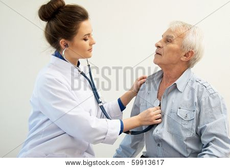 Senior man and doctor woman with stethoscope