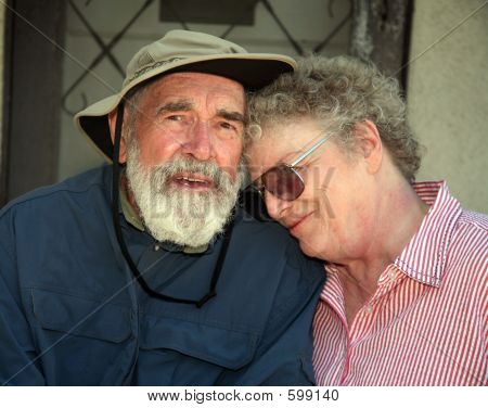 Elderly Couple On A Porch