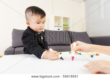 Aisa baby boy drawing at home