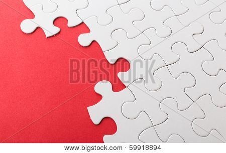 Incomplete puzzle with red missing part