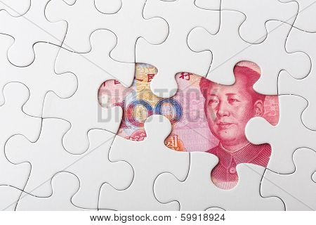 Chinese yuan and puzzle piece