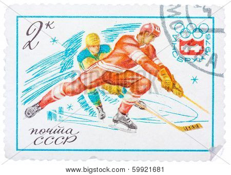 Stamp Printed In Russia (soviet Union) Shows Winter Olympic Games Emblem And Ice Hockey