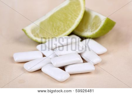 Chewing gum with fruit taste,   on wooden background
