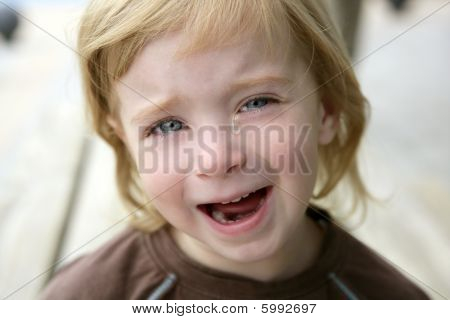Adorable Blond Little Girl Crying Portrait